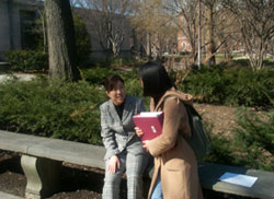Lee Chin-a and Gloria talking by a park bench