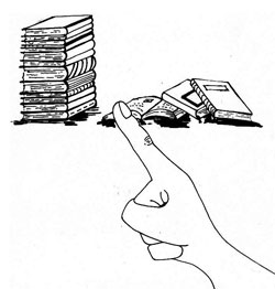 finger pointing at a stack of books