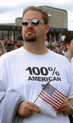 "man wearing a shirt that says ""100% American"""