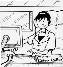 Karen Miller sitting at her desk