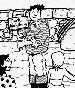 "boy holding up a sign with his name on it ""Mark Wahlburg"""