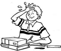 boy slapping himself in the forehead while studying.