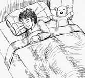 boy sleeping in bed with a teddy bear