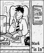 Mark working at his desk