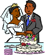 bride and groom in front of a wedding cake