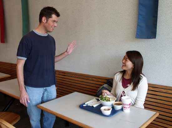 James and Su-mi talking in cafeteria