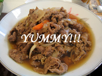 "bowl of stew with the word ""yummy"" printed across it."