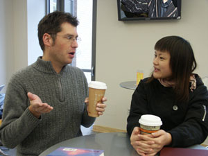 Jenny talking to James over coffee