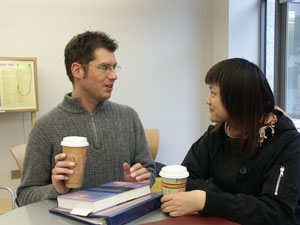 James and Jenny talking over coffee