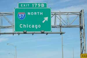 highway sign pointing the way to Chicago.