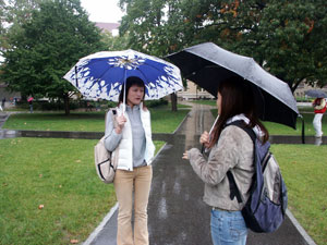 Jenny and Su-mi talking in the rain