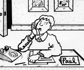 Paul sitting at his desk on the phone.